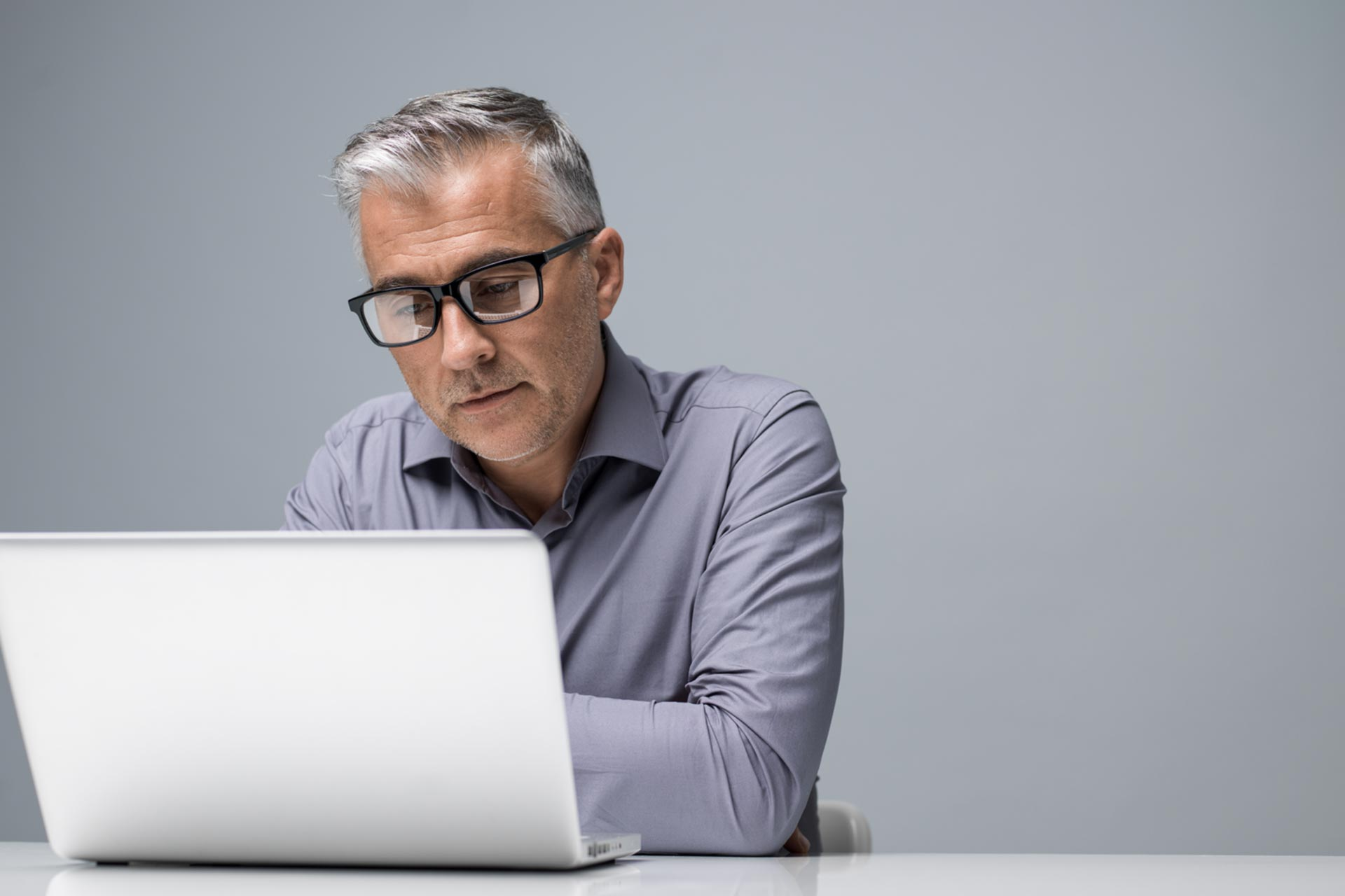 Man doing professional corporation work on his laptop