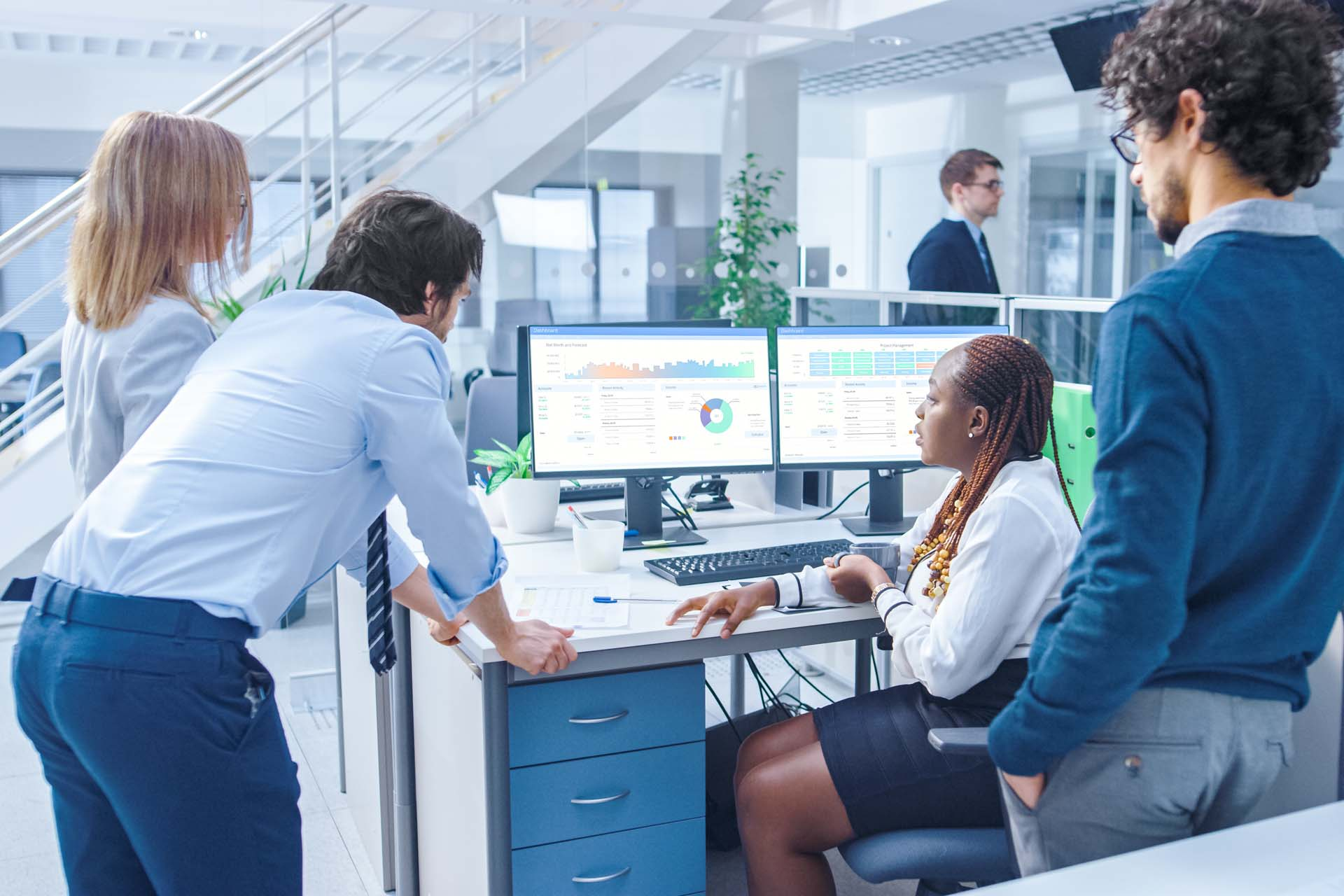 business people looking at computer monitors