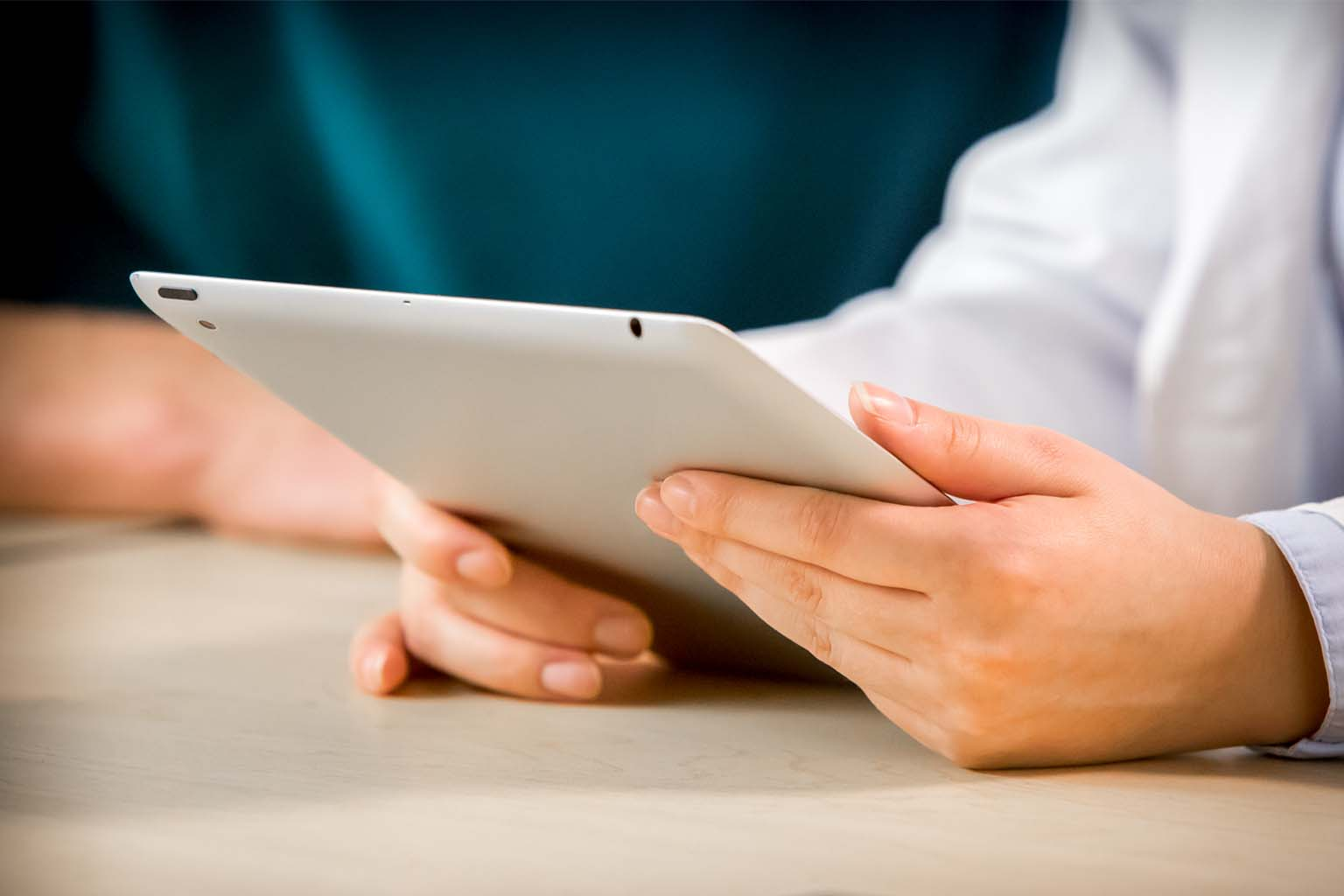 doctor hands holding a tablet