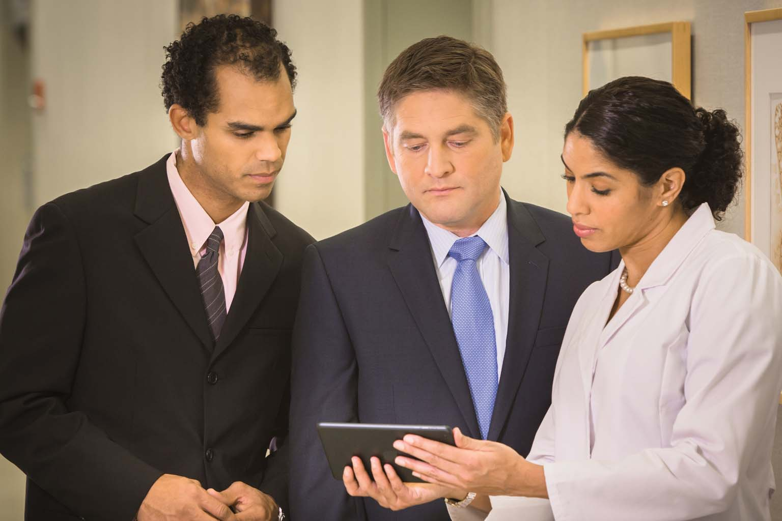 doctor with two businessmen discussing product