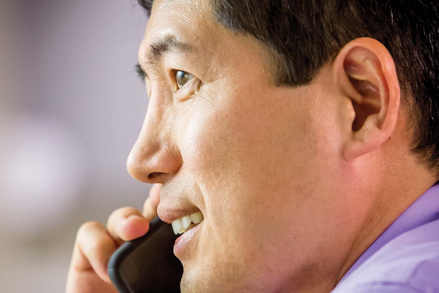 closeup of businessman talking on smartphone