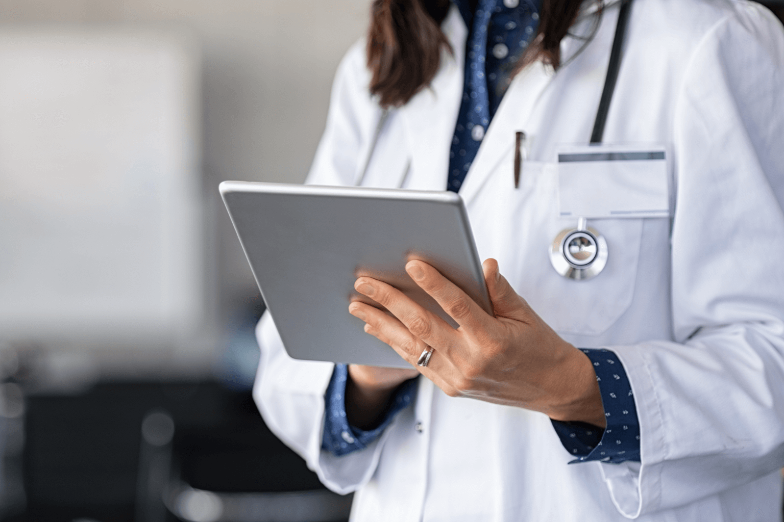 Close-up-of-woman-doctor-hands-using-digital-tablet-at-clinicjpg