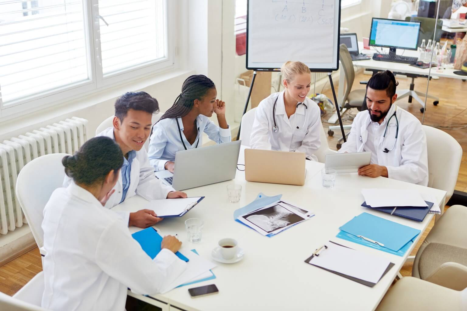 Physicians meeting at a table