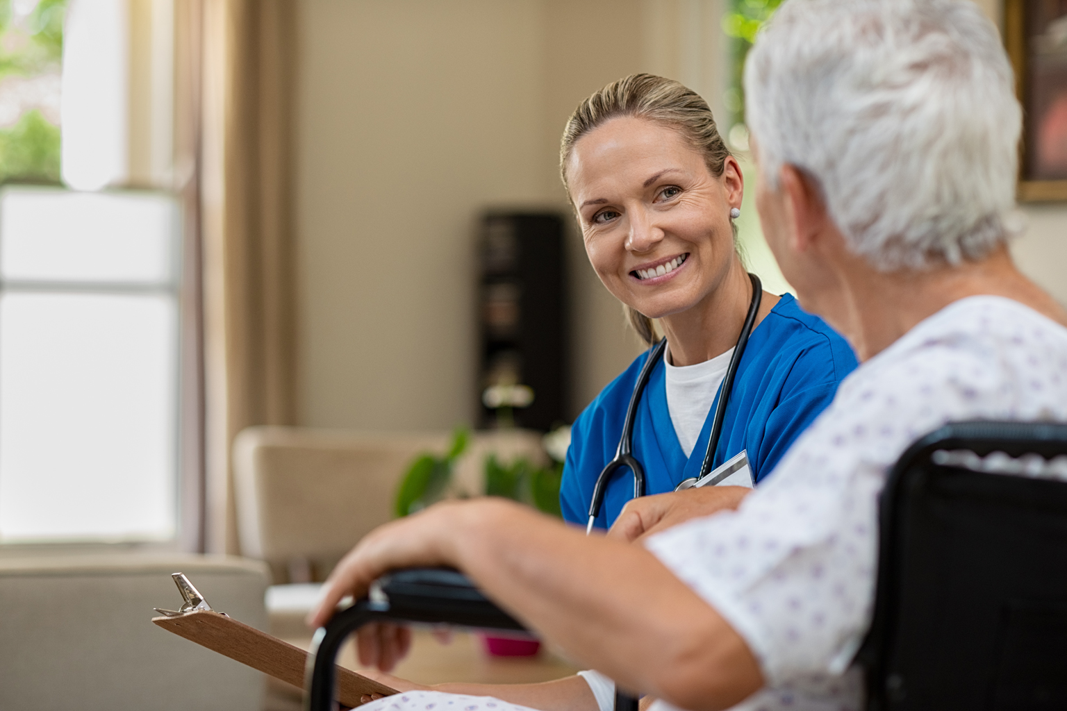 Home health nurse smiling at patient