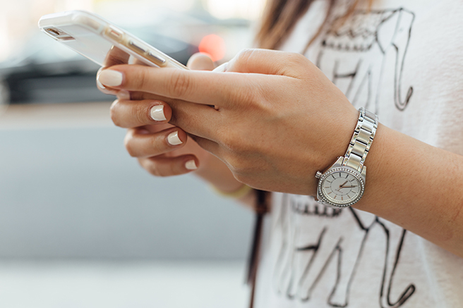 Close up on woman texting on smartphone