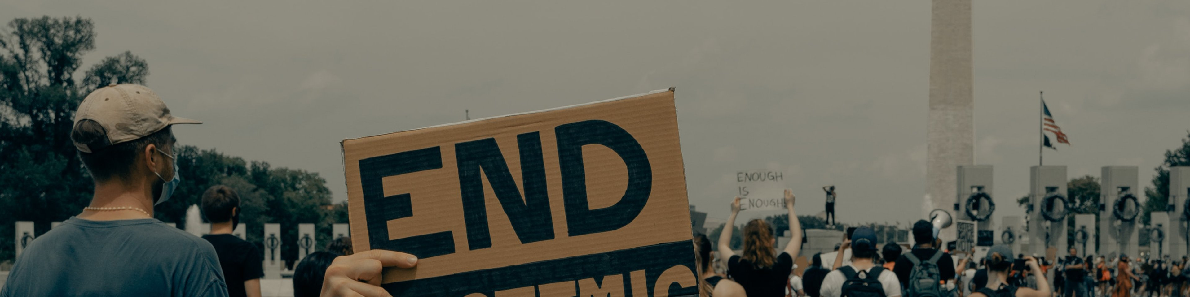 Hand holding end systemic racism sign at peaceful protest