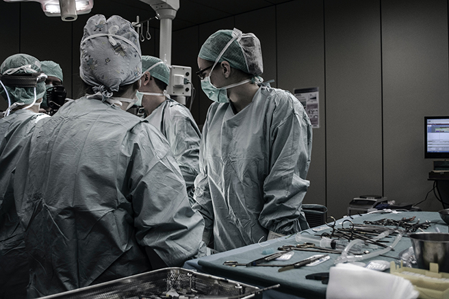 A PPE-covered medical team in an OR