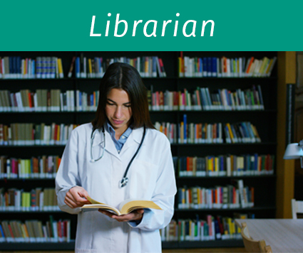 Female doctor in a library holding open book