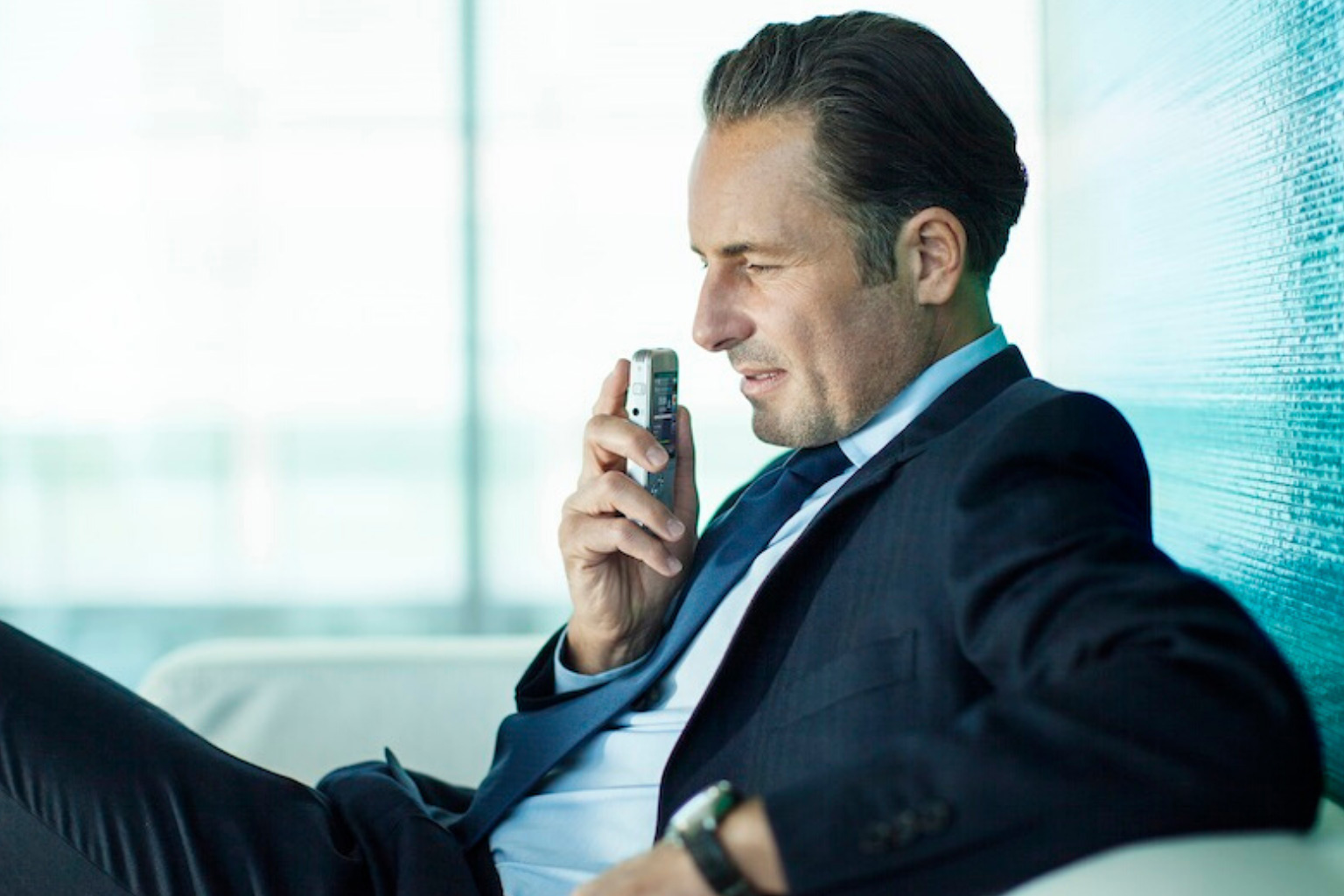 Business man using dictaphone