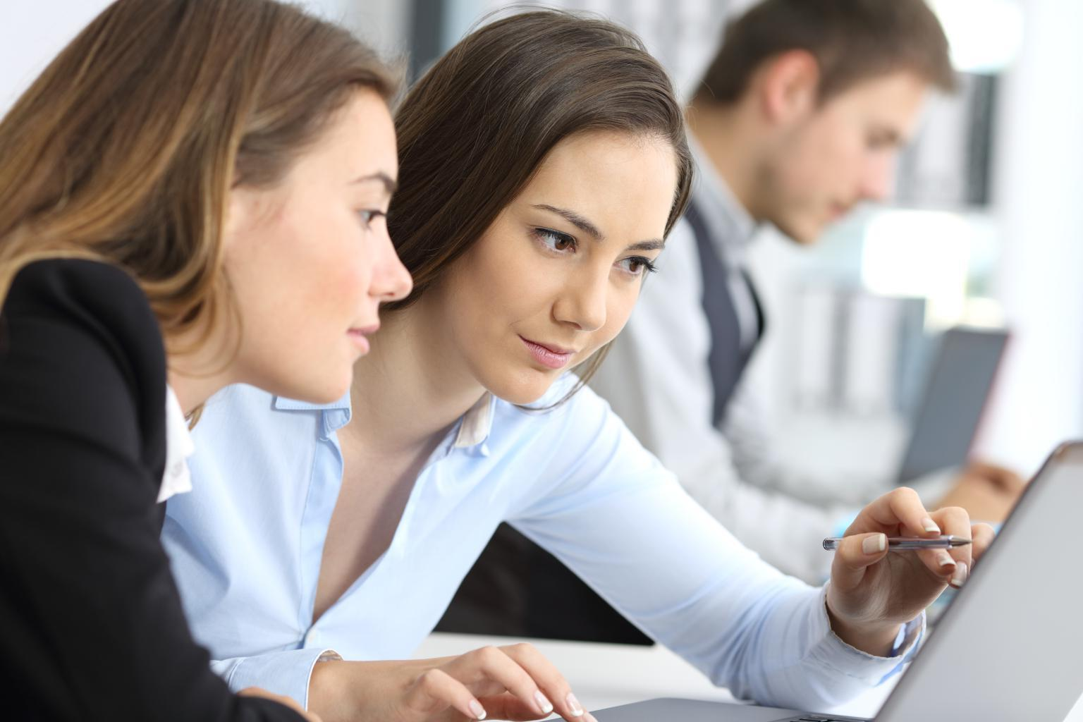 two woman reading article about running your business